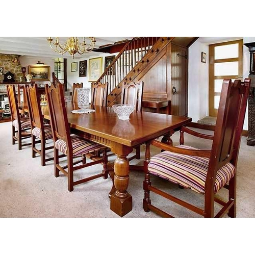 24 - An impressive Peter Blomfield Cuban mahogany dining table with two drawers and wish bone stretcher b...