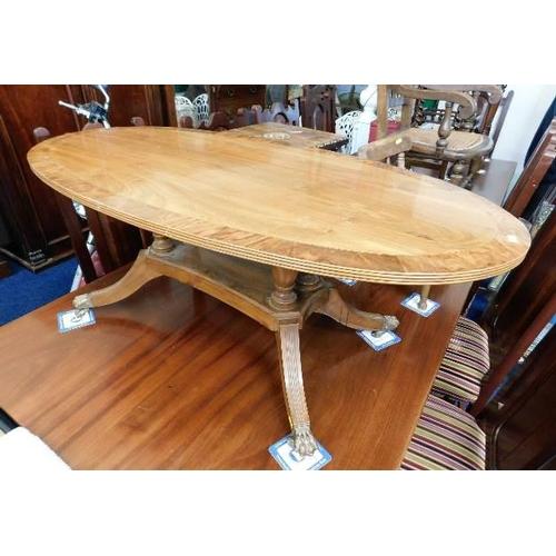 25 - A Peter Blomfield walnut coffee table...