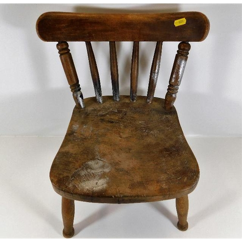 26 - A small 19thC. elm childs chair...