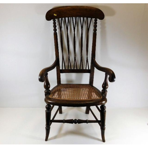 28 - A c.1900 armchair with cane seat & twist stick back...