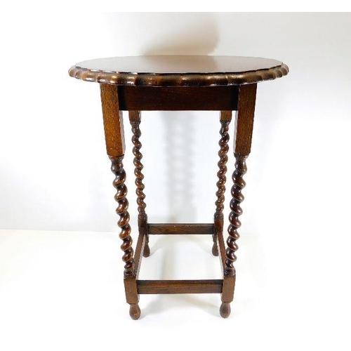 29 - An oak barley twist occasional table...