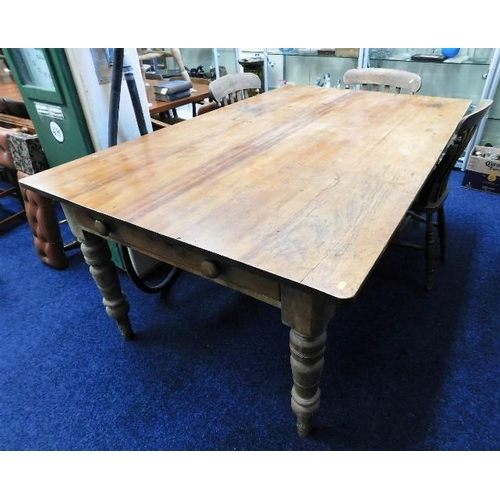 40 - A large 19thC. pine farmhouse table with two drawers with three elm dining chairs 72in long x 45in w...