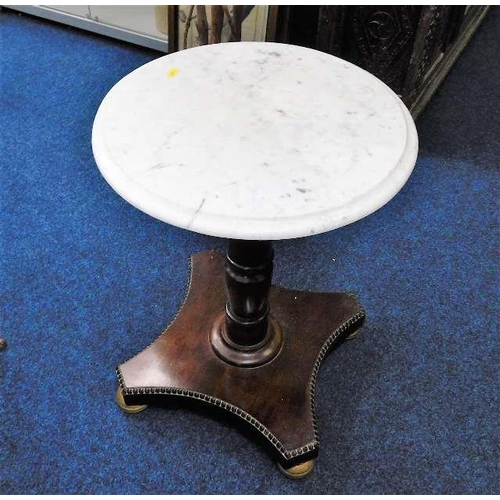 41 - A low level marble topped pedestal table...