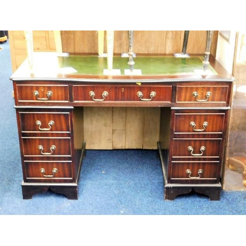 46 - A 20thC. pedestal desk with brass fittings...