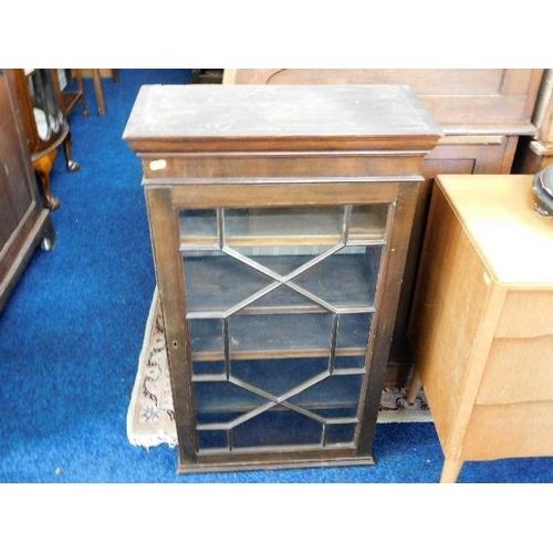 49 - A small mahogany wall cabinet...
