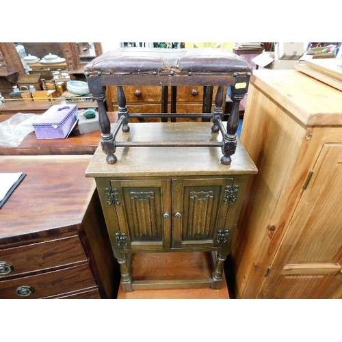 5 - A small oak Old Charm style cupboard twinned with a leather covered foot stool...