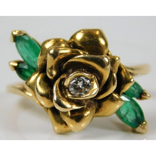 34 - A 14ct gold ring with rose design set with diamond & emerald 6.7g size N...
