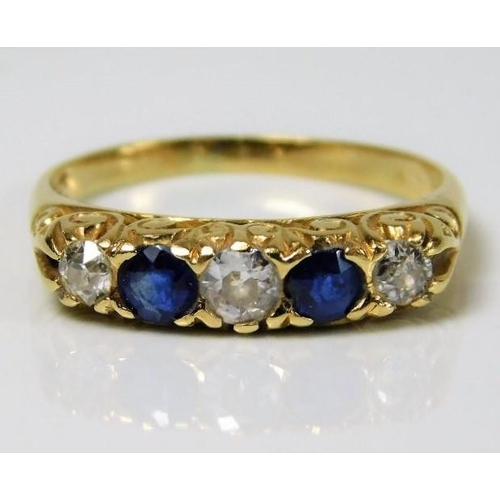 43 - An 18ct gold ring set with approx. 0.35ct diamond & sapphire 2.7g size M/N...