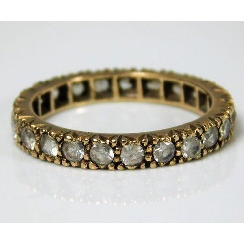 46 - A 9ct gold eternity ring set with paste stones 2.4g size M/N...