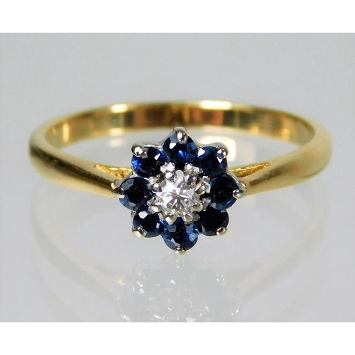47 - 18ct gold daisy style ring set with diamond & sapphire 2.6g size N...
