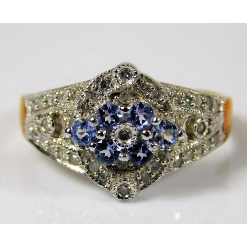 51 - A 9ct gold ring set with approx. 0.28ct diamonds & topaz size R...