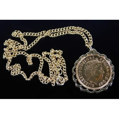 9 - A 9ct gold mounted year 2000 full gold sovereign with 9ct gold chain 16.1g...