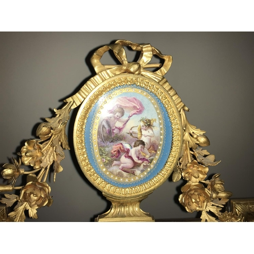 1063 - Porcelain and gilt metal decorative Sevres style table mirror. Oval bevel edged mirror surrounded by...