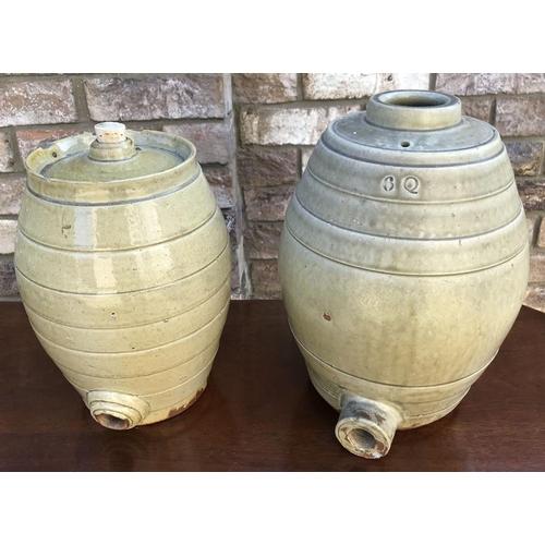 18 - Pair of stoneware wine barrels 6 quart. 32cm h and 27cm h....