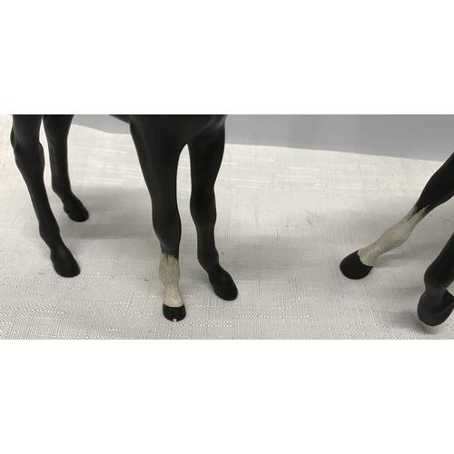 24 - Beswick black horse and foal, 18cms h and 15.5cms , matt finish glaze....