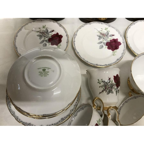 26 - Royal Staffordshire tea service ''Roses to Remember'' teapot, large plate, milk, sugar bowl, 12 cups...