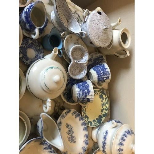 49 - A quantity of 19thC + 20thC miniature ceramic and metal pots, pans, plates etc with ceramic animals,...
