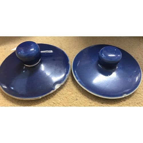51 - A pair of 19thC Chinese cobalt blue glazed ginger jars and covers. 22cms h....