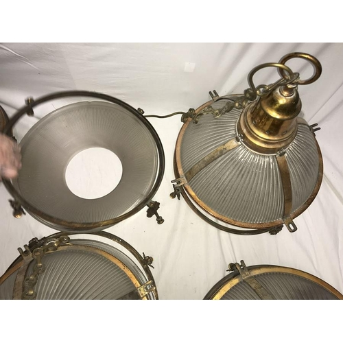 1206 - Seven large original hanging Holophane lights with galvanised brass fittings and hanging chains. 37c...