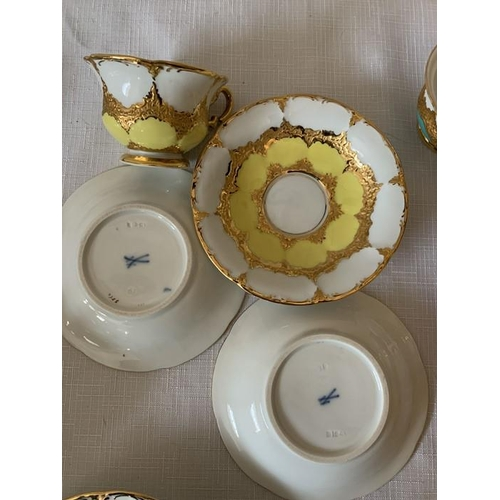343 - A continental harlequin and gilt porcelain coffee service with blue mark to base, six cups and sauce...