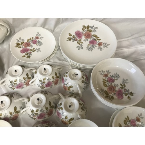 18 - A quantity of Wedgewood dinnerware. Twenty one  pieces of