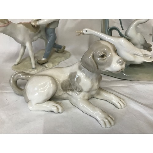 23 - A group of Lladro and Nao Llado figures to include: Nao Grey and White Dog 10cms h x 18,5cms l, Llad...