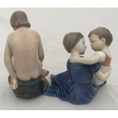 25 - Two Danish figurines. One Royal Copenhagen nude female 4027 14cms h and a B&G girl with small child ...