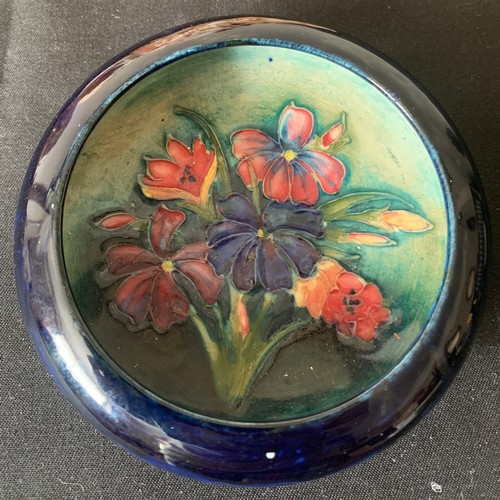 53 - A Moorcroft circular dish, 11.5cms h, blue ground with floral decoration.