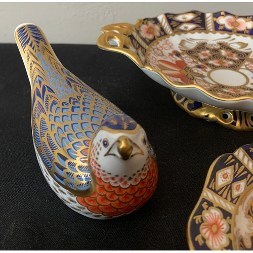 55 - Royal Crown Derby bird paperweight with gold stopper and two Royal Crown Derby dishes, largest 18 x ...