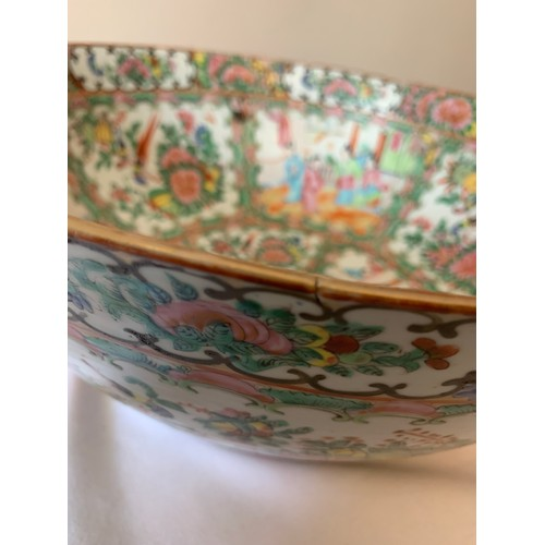 58 - A 19thC Cantonese famille rose punch bowl. 37cms d.