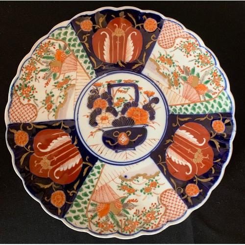 59 - An Imari pattern plate, 31cms d.
