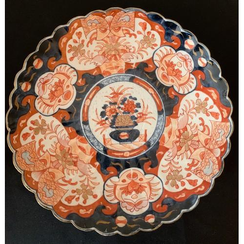 60 - A 19th Imari pattern plate, 30cms d.