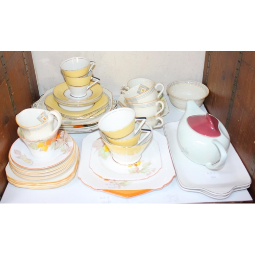 30 - SECTION 30. A collection of assorted ceramic tea wares including a Palissy Art Deco part set, a Carl...
