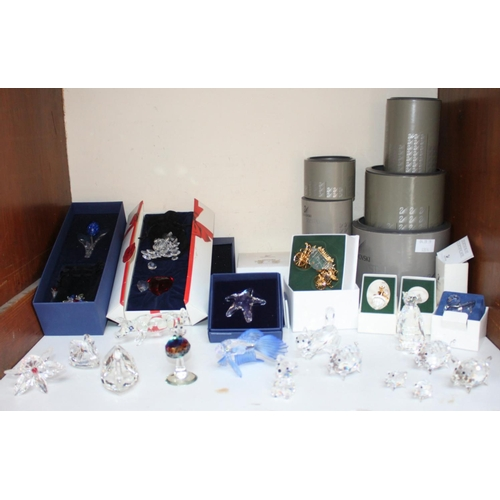 1 - SECTION 1.  Twenty various Swarovski Crystal ornaments, with numerous original boxes and packaging e...