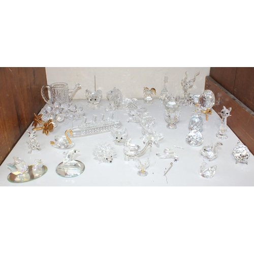 17 - SECTION 17. A good collection of assorted glass ornamental figures, predominantly Swarovski examples...
