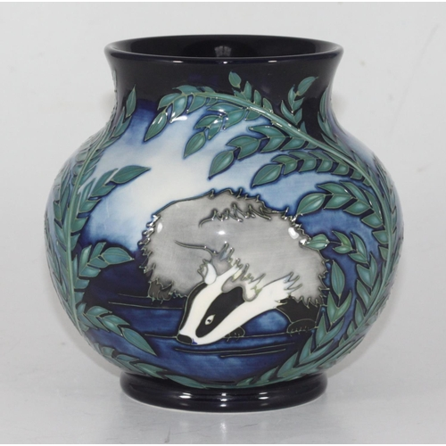 49 - A Moorcroft pottery vase in the 'Moonlight Badger' pattern designed by Vicki Lovatt, of compressed g...