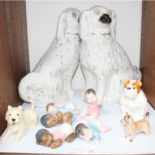 21 - SECTION 21.  A pair of 19th century Staffordshire pottery large seated spaniels, together with a Bes...