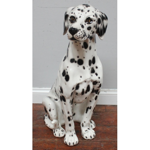 58 - A life size ceramic model of a seated Dalmatian dog, 78cm tall...