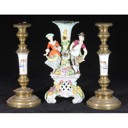 60 - A 19th C German porcelain candelabrum base, probably Sitzendorf, modelled with a pastoral couple on ...