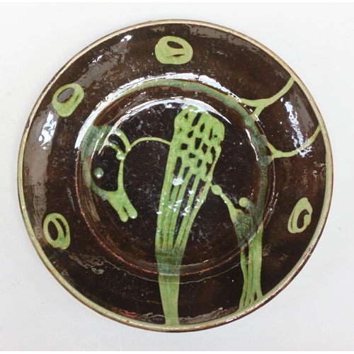 62 - Michael Cardew O.B.E. (1901-1983) Winchcombe Pottery circular dish, decorated with a bird in green t...