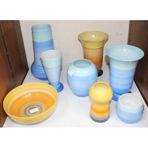 31 - SECTION 31. A collection of eight assorted Shelley ceramic bowls and vases from the 'Harmony' range,...