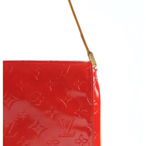 feb55d953334 459 - LOUIS VUITTON - a red Monogram Vernis Thompson Street flap handbag.  Designed with