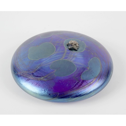 10 - A John Ditchfield Glasform paperweight, of iridescent blue glass, decorated with painted lily pads a...