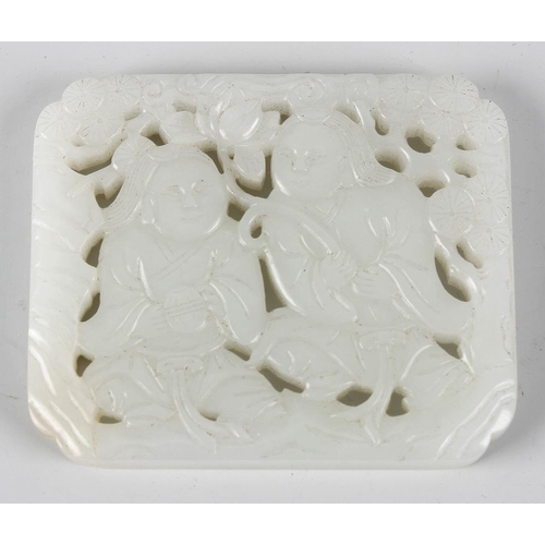 103 - A Chinese carved and pierced white jade pendant, of rectangular form, depicting two seated figures, ...