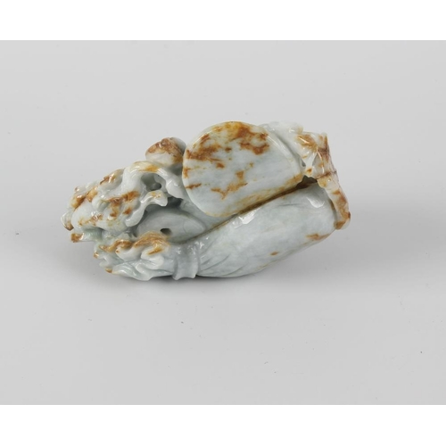 107 - A Chinese carved jade figurine, modelled as a reclining Buddha, 4.25 (11cm) high.  <br>Appears to be...