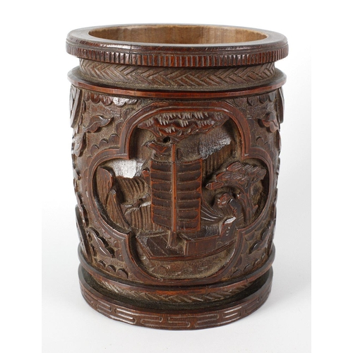 114 - A Chinese bamboo brush pot, the front with carved panel depicting a sailing junk, the reverse panel ...