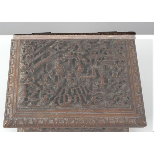 120 - A Chinese Canton carved softwood jewellery box. Circa 1900, the hinged rectangular cover carved in d...