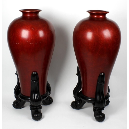 124 - A pair of unusual large Chinese red lacquered vases, each of slender baluster form, with compressed ...
