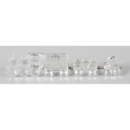 13 - A Swarovski crystal steam train with three separate Swarovski carriages, train 2.5 (6.5cm) long.  <b...