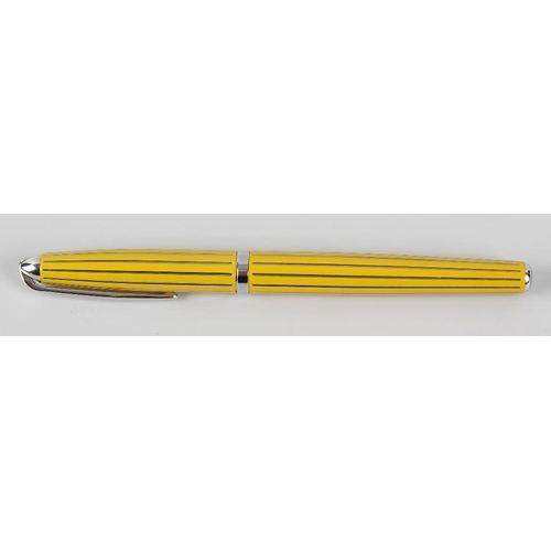 134 - A Thomas Lyte sterling silver and lacquer ballpoint pen. The body and cap with mustard yellow lacque...
